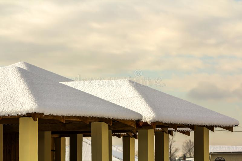 Roof of outdoor alcove covered with snow in winter.  stock photo