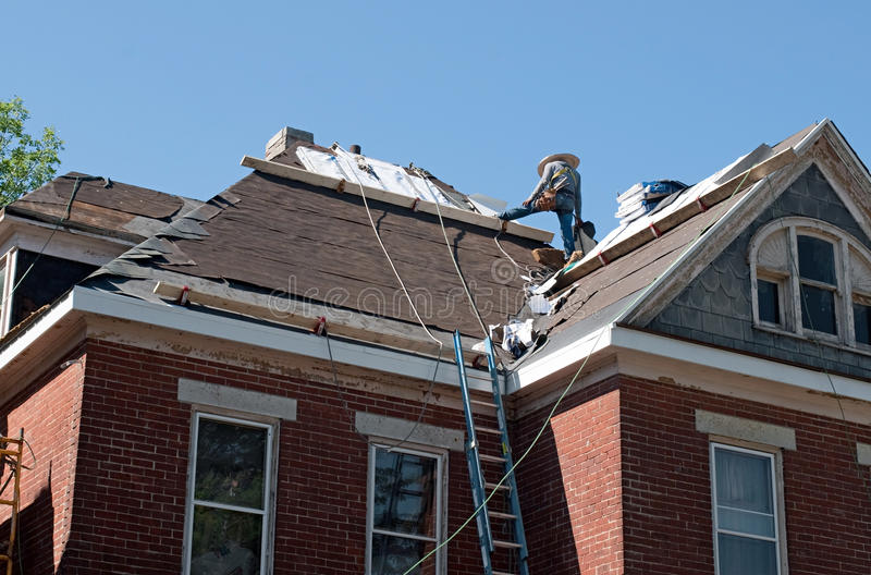 Roof Repair on Historic House. Roof being replaced on old historic house royalty free stock photo