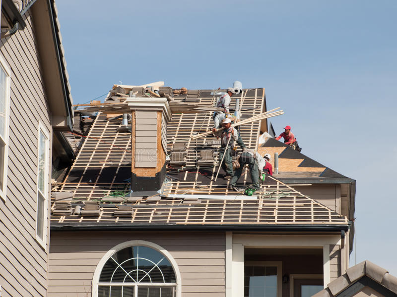 Roof Repairs. Of an apartment building in Colorado stock photo