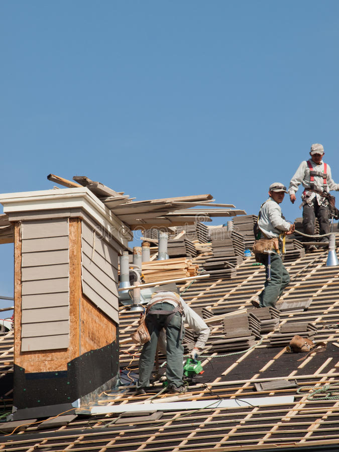 Roof Repairs. Of an apartment building in Colorado stock images