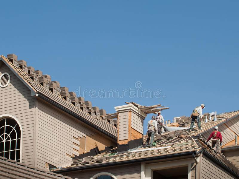 Roof Repairs. Of an apartment building in Colorado royalty free stock image