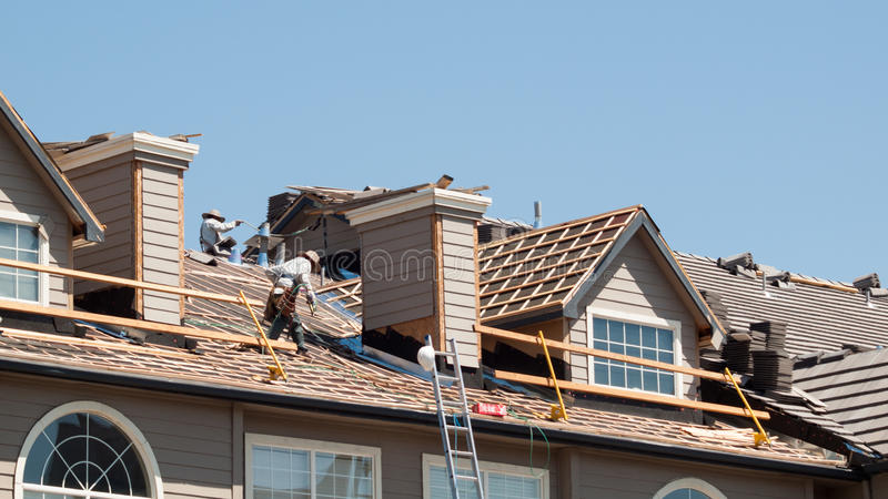 Roof Repairs. Of an apartment building in Colorado royalty free stock images