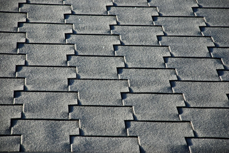 Roof and Shingles. The morning sun illuminates and shadows this section of roof and shingles royalty free stock image