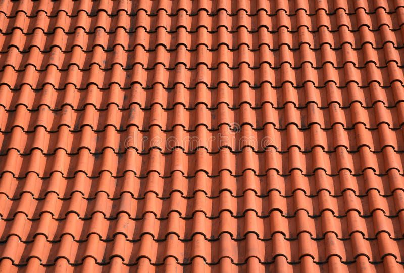 Roof shingles, orange tiles background stock photography