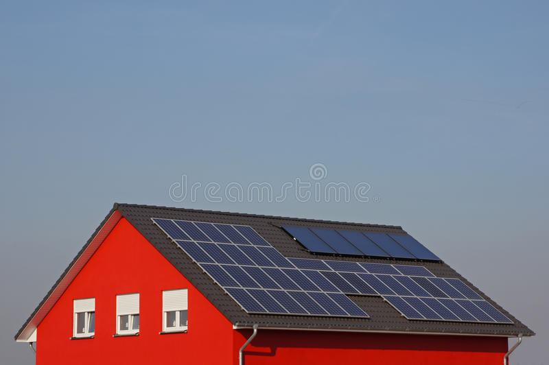 Roof with solar cells royalty free stock photo
