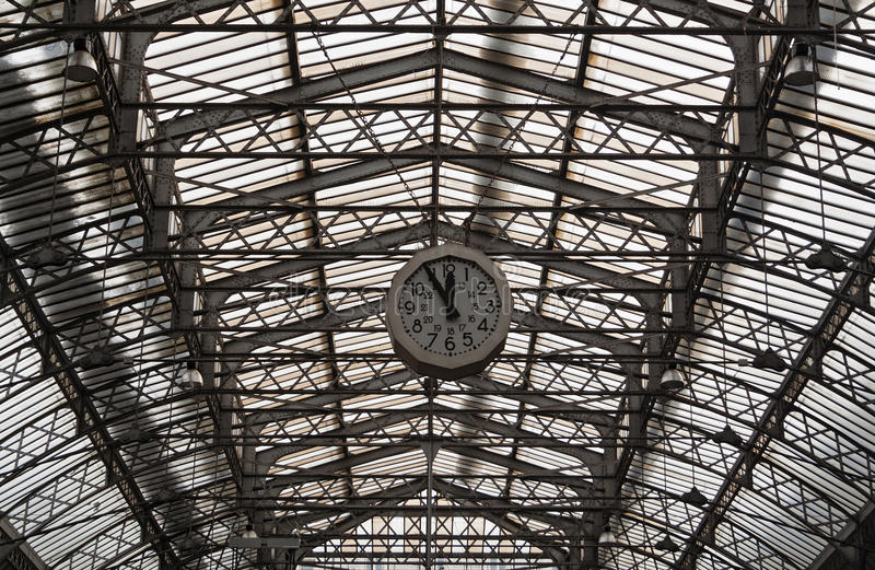 Roof structure of the Paris railway station Gare de l`Est with clock stock photography