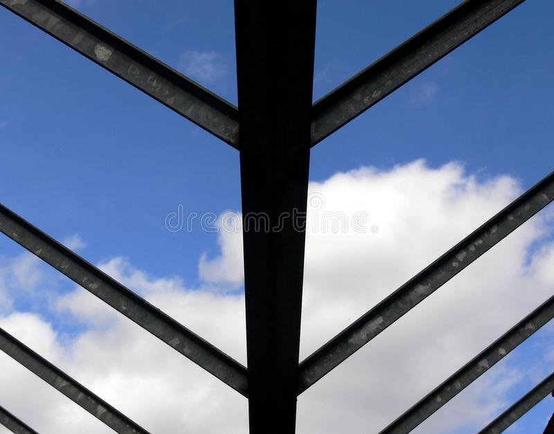 Roof substructure made of steel girders. Roof made of steel beams as an underside, new construction of a factory Building, stable roof construction made of steel royalty free stock image