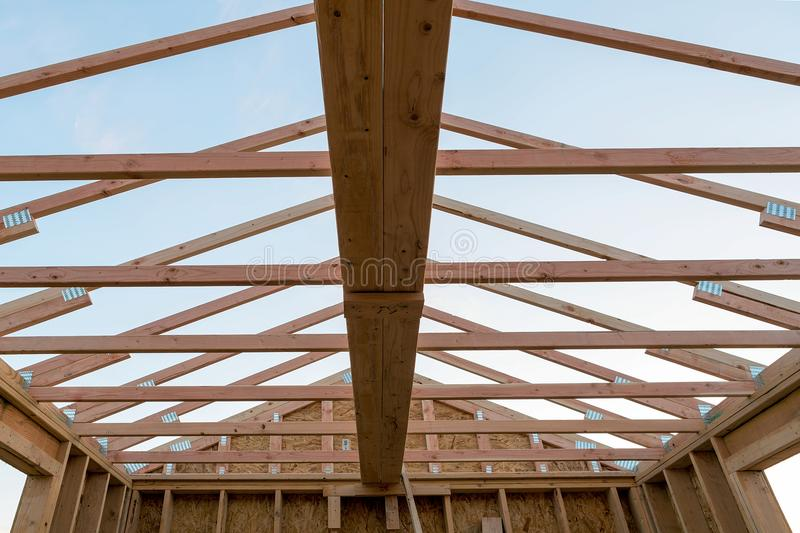 Roof Support Beam in New Home Construction. Roof support beams and wood studs framing in new home construction stock images