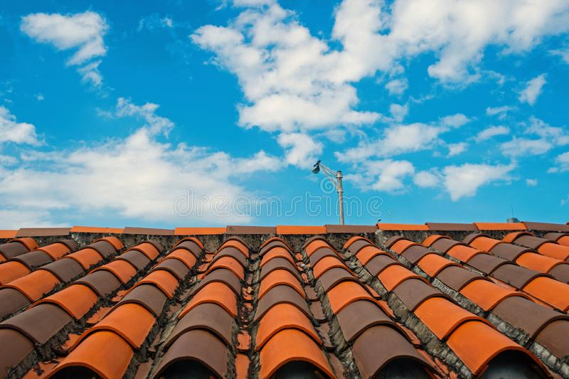 Roof with terracotta tile in miami, usa. Tile roofing on cloudy blue sky. Architecture and design. Rooftop with ceramic. Roof with terracotta tile in mi, usa royalty free stock images