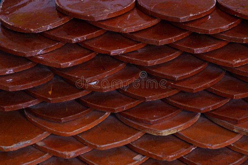 Roof texture at top of temple . ceramic material clay surface . royalty free stock photo