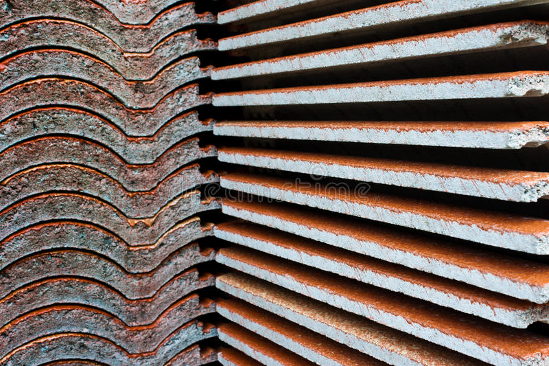 Roof tile stack. Building under re-construction demolished roof tile before royalty free stock images