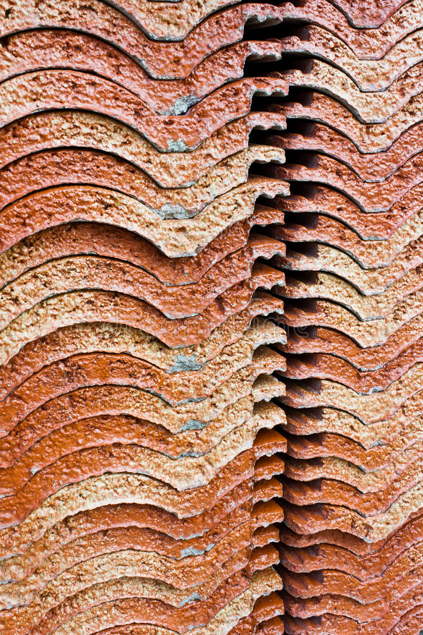 Roof tile stack. Building under re-construction demolished roof tile before stock photography