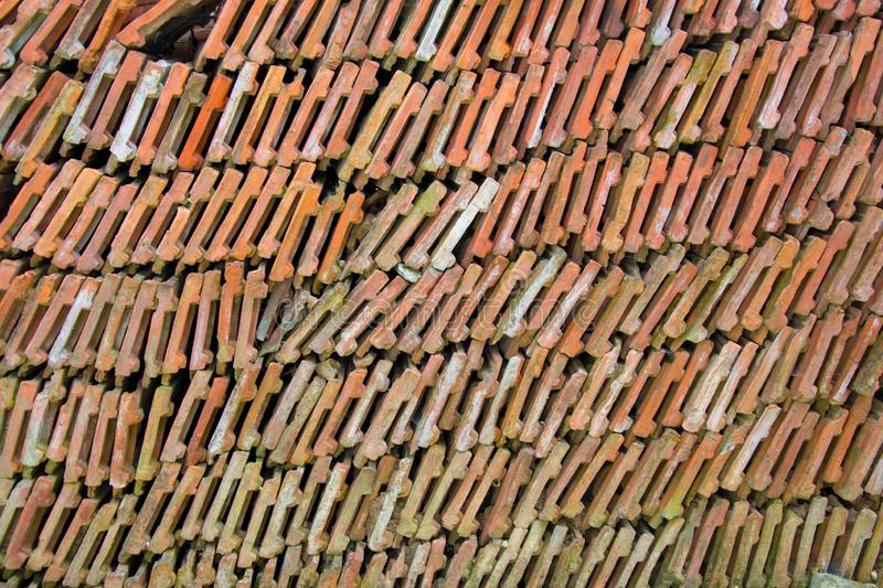 Stack of roof tiles, bricks arranged, full frame. Roof tiles arranged in a perfect rows, construction tiles, industrial scene stock images