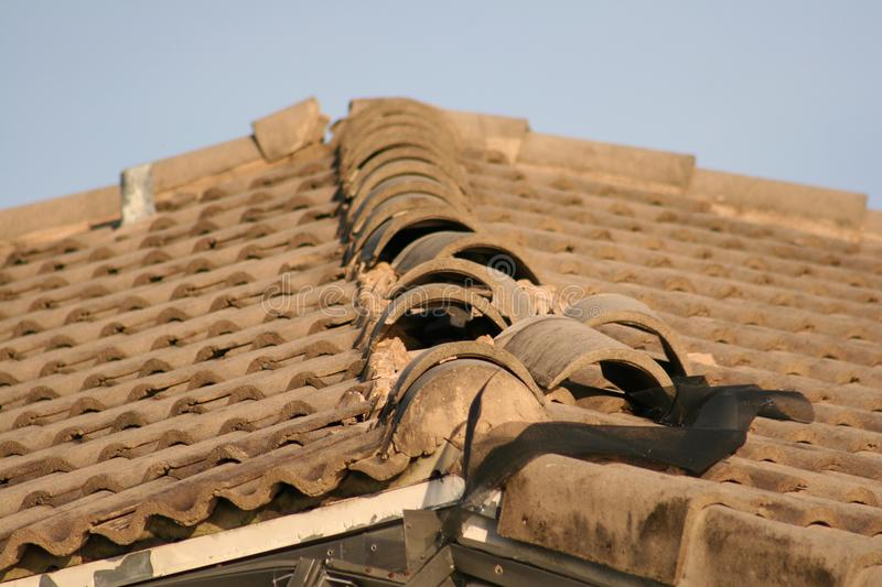 Roof tiles are ripped up from Hurricane winds. stock photography