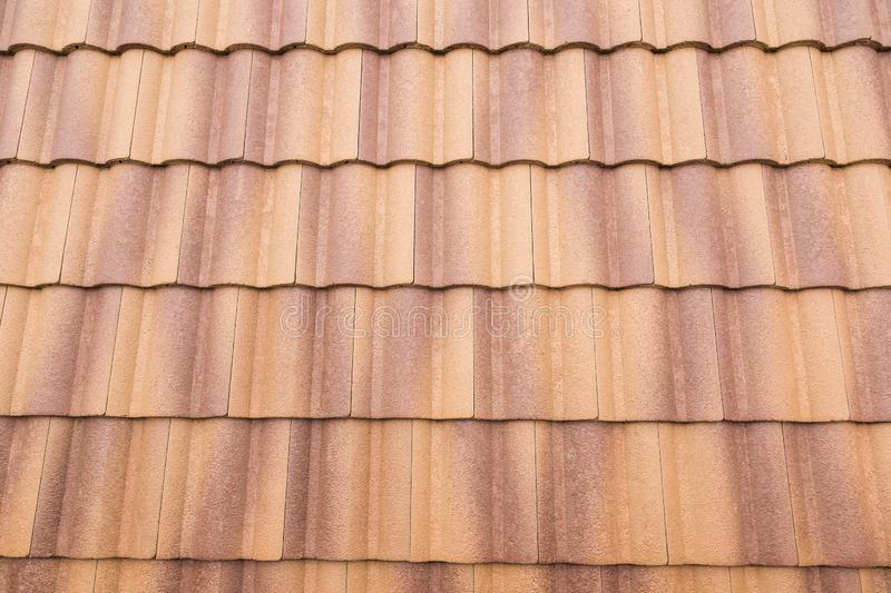 Roof tiles and sky sunlight. Roofing Contractors concept Installing House roof royalty free stock image