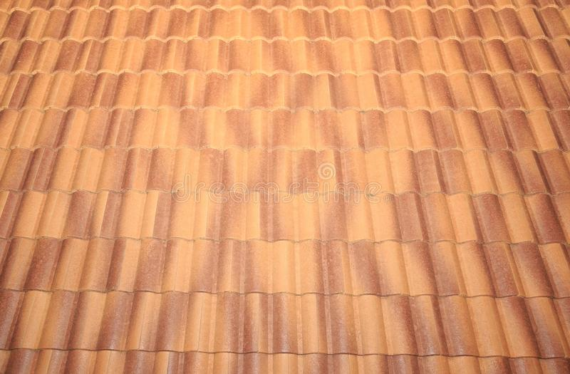 Roof tiles and sky sunlight. Roofing Contractors concept Installing House roof. people can be used as a background card stock image