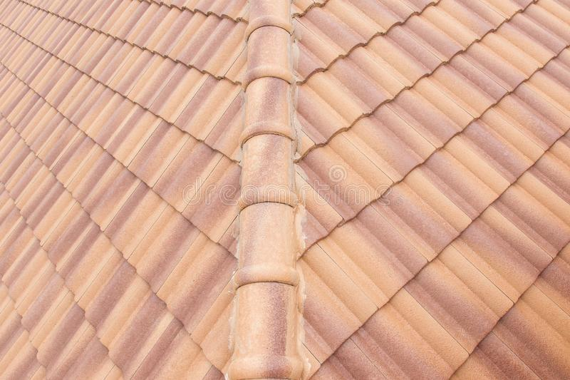 Roof tiles and sky sunlight. Roofing Contractors concept Installing. House roof royalty free stock photo