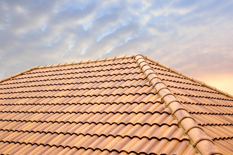 Roof tiles and sky sunlight.Roofing Contractors concept Installing House roof. royalty free stock images