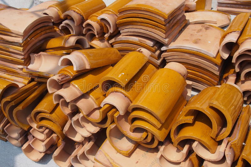 Roof tiles. Yellow Enameled Roof tiles prepare for construction stock images