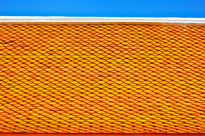 Roof tiles. Yellow roof tiles over blue sky stock photos