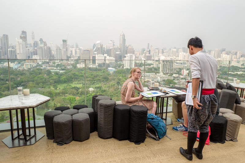Roof top bar overlooking Lumpini park in Bangkok stock images
