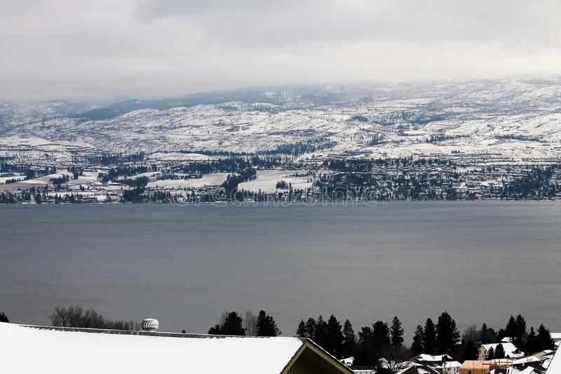 Roof top winter scenic. Winter in the Okanagan, a view from across the lake royalty free stock photos