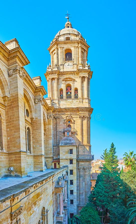 Bell tower of Malaga Cathedral, Spain. The roof tour on Malaga Cathedral with a view on its side wall and tall bell tower, Spain royalty free stock photo