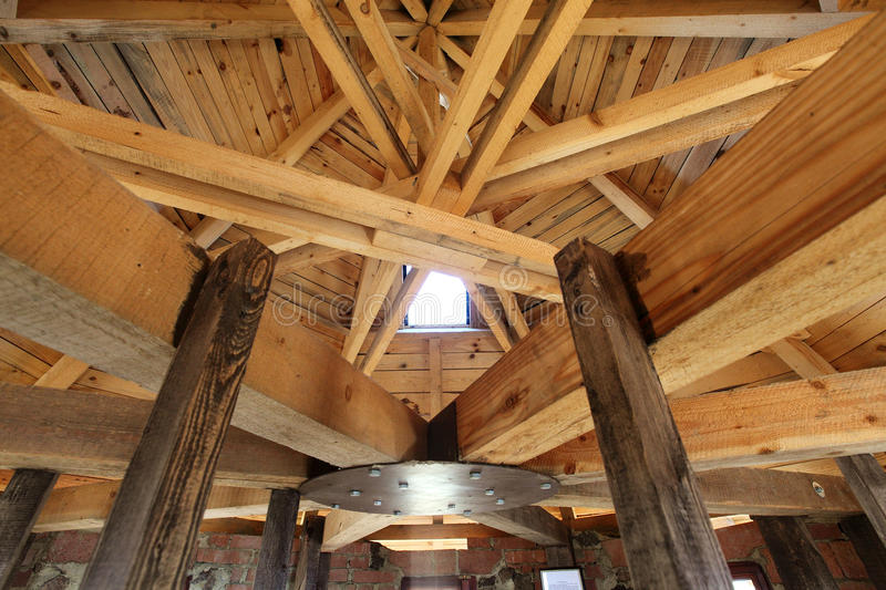 Roof truss. Made up of many timber beams and a lookout tower royalty free stock photo