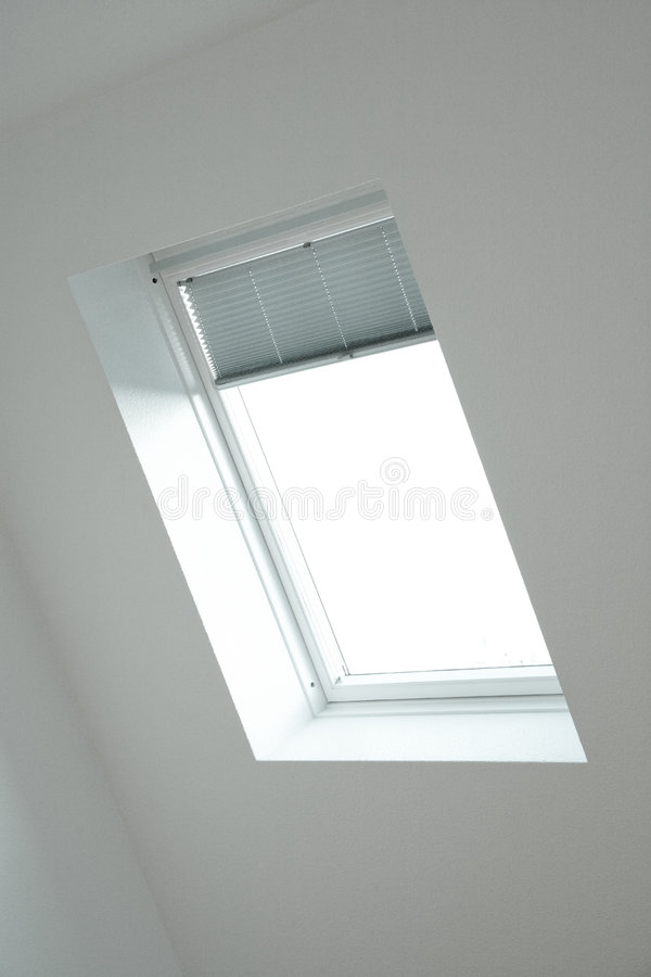 Roof window. With back-light and white wall royalty free stock photo