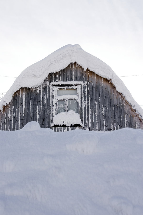 Roof and window covered with snow stock photography