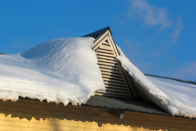 Roof window covered with snow stock image