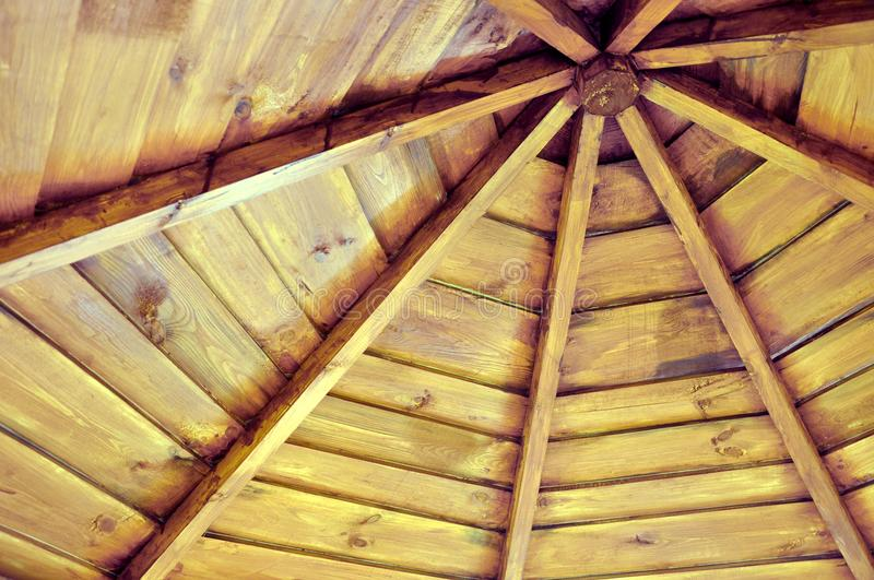 Roof of a wooden gazebo from the inside stock photos