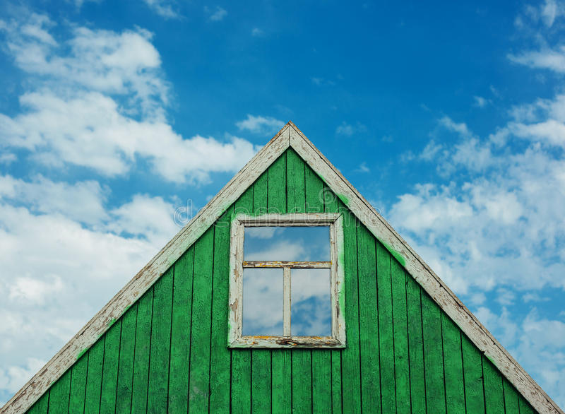 Roof of wooden house with a blue sky in the background royalty free stock photography