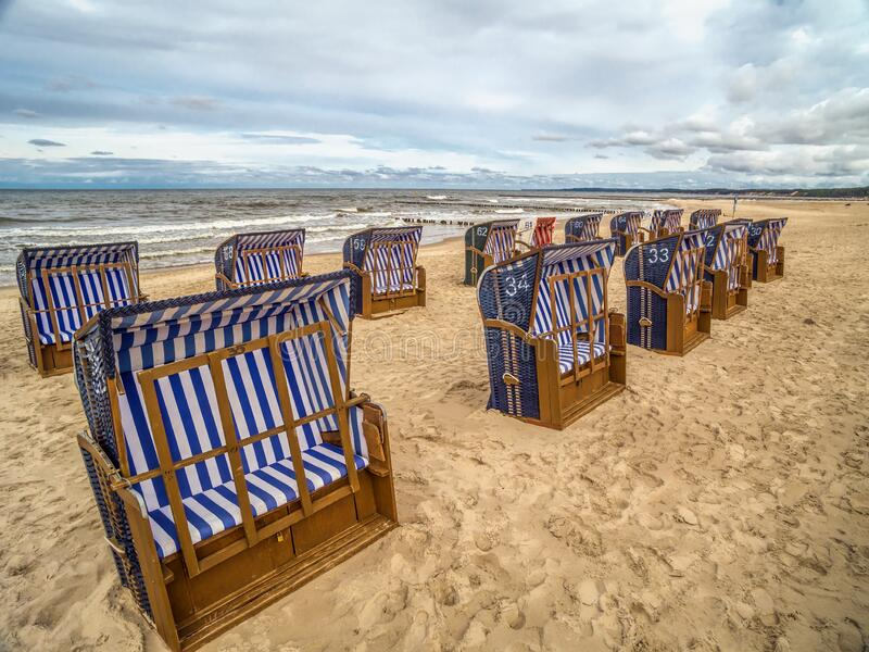 Roofed wicker beach chairs stock photos