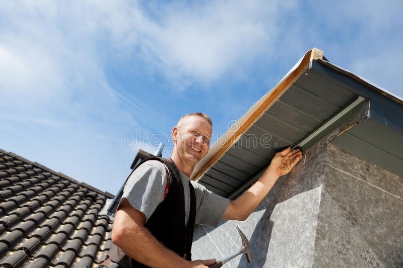 Roofer assembling parts of the dormer stock photography