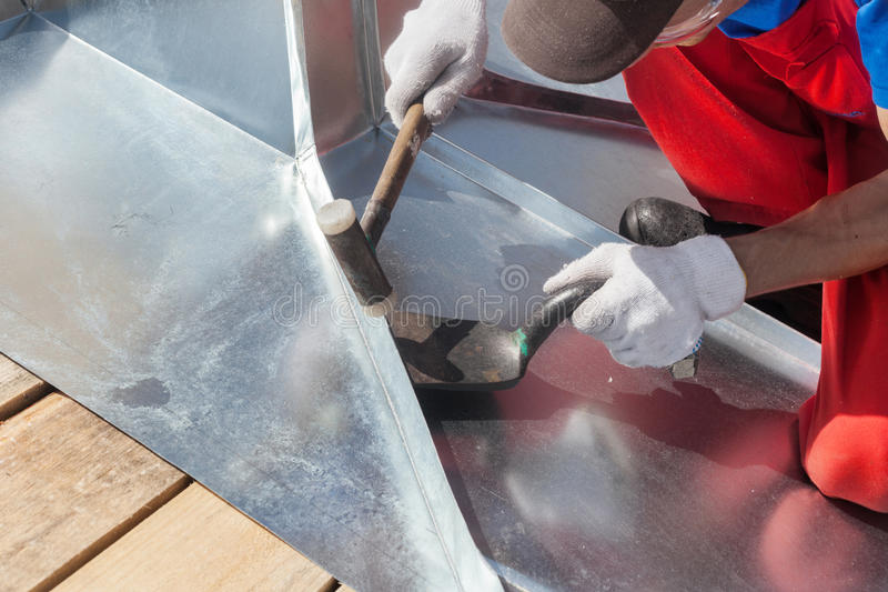 Download Roofer Builder Worker Finishing Folding A Metal Sheet Using Rubber Mallet. Stock Image - Image of mallet, expert: 84657379