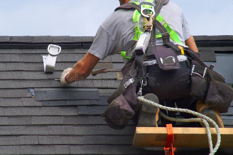 Roof repair construction worker roofer man roofing security rope royalty free stock images