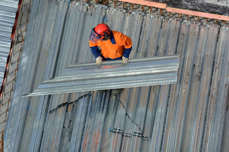 Roofer construction worker in a construction site royalty free stock image