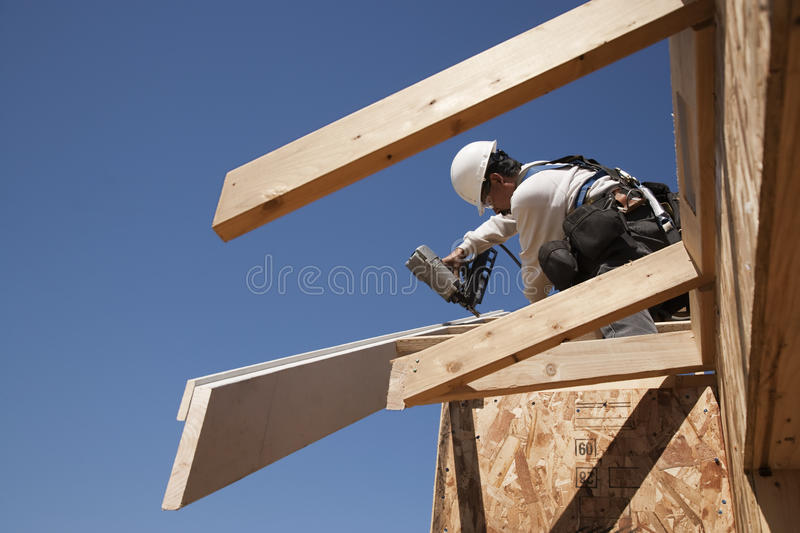 Roofer fixing beams on roof royalty free stock image