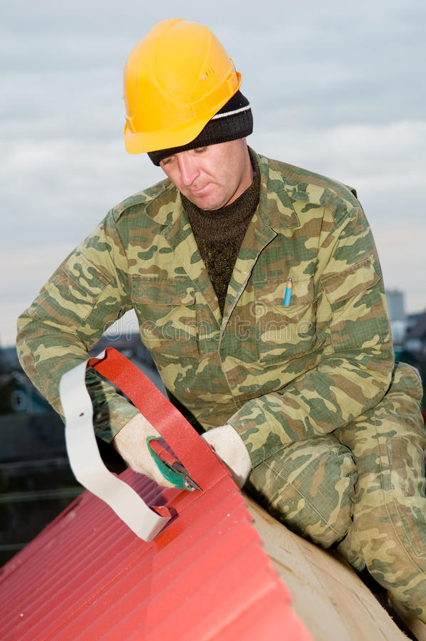 Roofer with hand snips