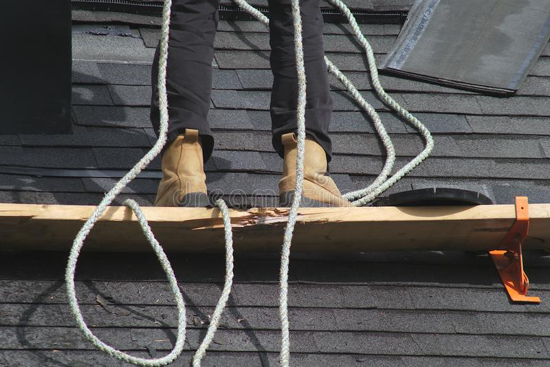 roofer work roof security construction safety harness royalty free stock photos