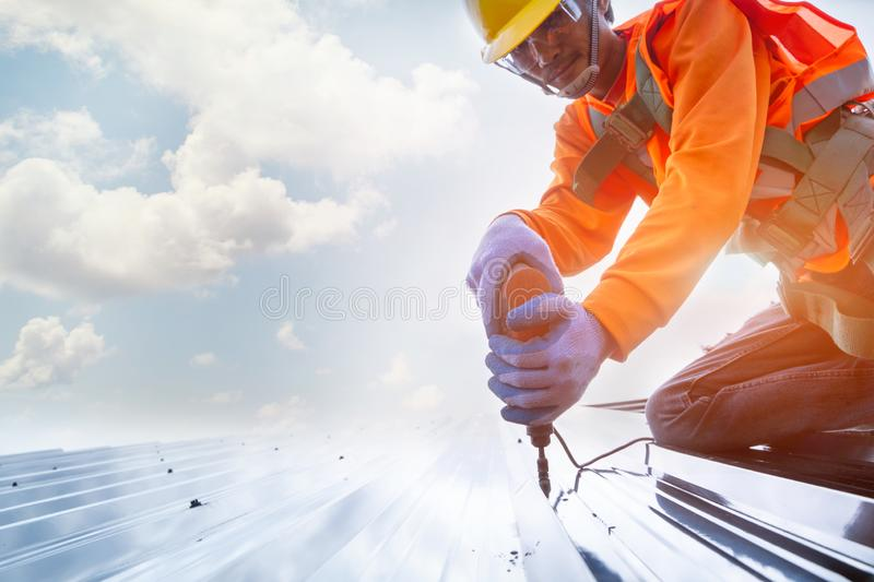Roofer worker in protective uniform wear and gloves stock images