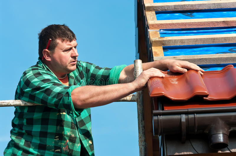 Roofer Working Stock Photo