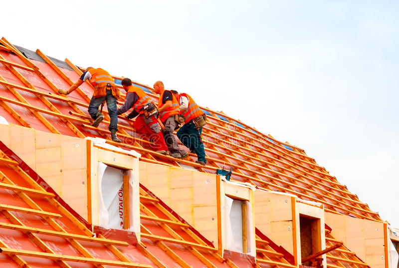 Download Roofers on the roof. editorial photo. Image of tool, people - 52807121