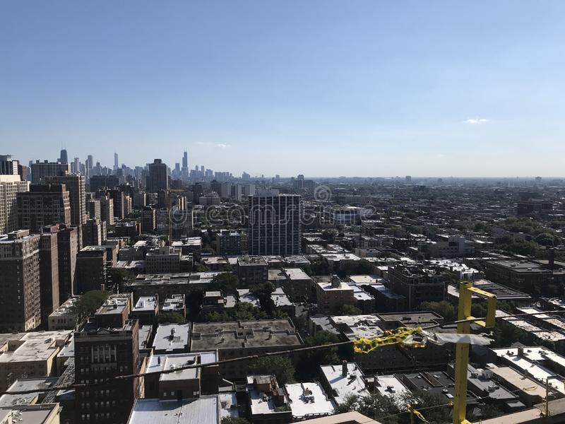 Roofers View of Chicago from rooftop while working on a smooth modified flat roof, roofing project royalty free stock photos