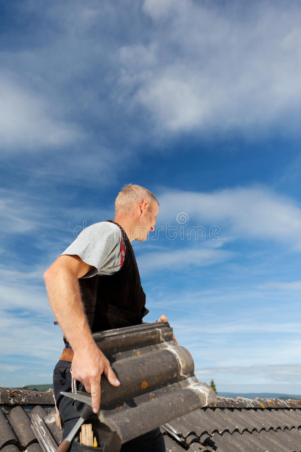 Man Carrying Slate Up Ladder Stock Photo Image Of Clouds