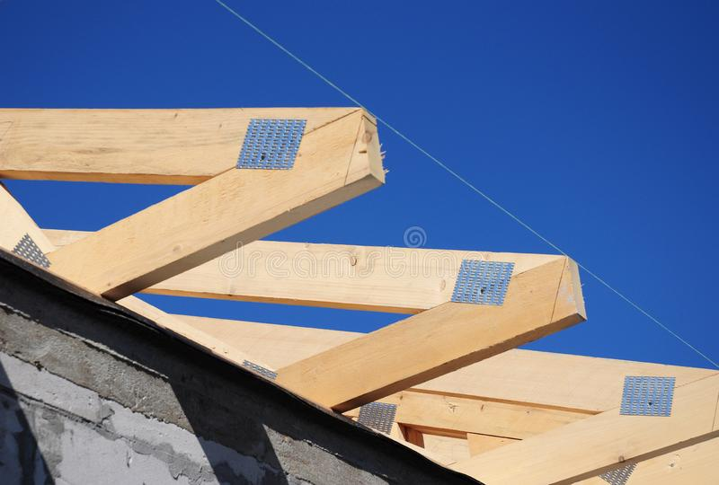 Roofing construction house with wooden beams, trusses, frame, timber and measurement tape. Photo stock photo
