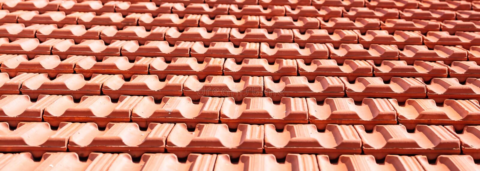 Roofing construction. Roof ceramic tiles texture background royalty free stock image