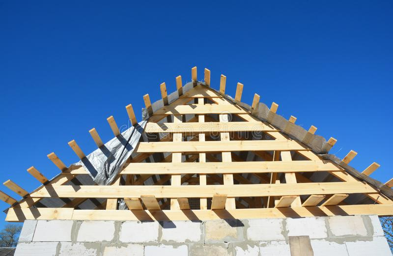 Roofing Construction. Wooden roof top frame house construction  with wooden roof beams, trusses, timber. Photo stock images
