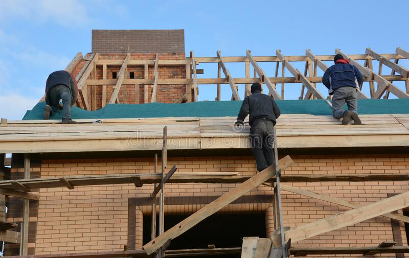 Roofing Contractors Installing House Framework, Roof Board. Roofing Contractors. Rooftop Repair. Close up stock photos